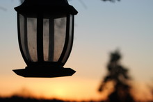 Sunset Behind A Bird Feeder An...