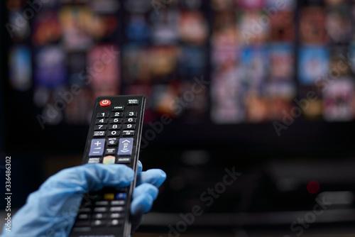 Tablou Canvas Watching TV or Online video streaming service during Coronavirus self-quarantine