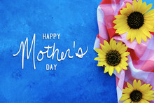 Yellow Sunflower Blooms On Blue Background With Happy Mother's Day Message.