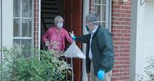 A Senior Citizen Using A Walke...