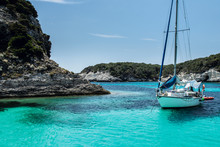 Anchored Sailboat In A Calm Bay In Summer Day/vacation, Mediterranean, Bonifacio, Corsica, France, Europe