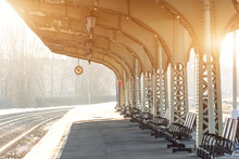 Empty Platform With Clock At Railway Station, Sunny Day.