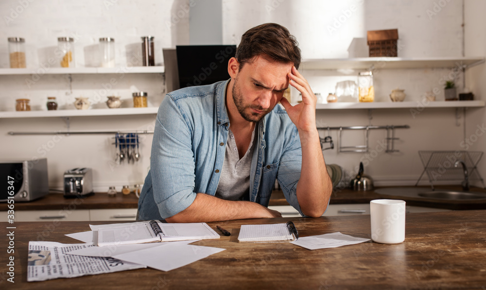 Fototapeta Boy has problems with bills. Concept of economic trouble and failure