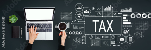 Fototapeta Tax theme with person using a laptop computer obraz