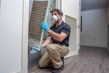 HVAC Worker Removing Air Filter