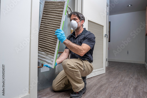 HVAC Worker Removing Air Filter Canvas Print