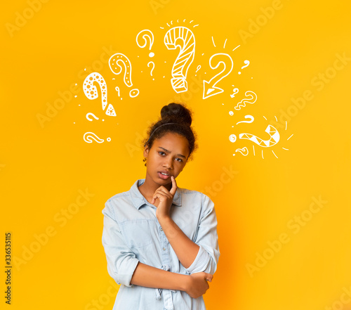 Fotografia, Obraz Puzzled pensive young african american teen girl with question marks