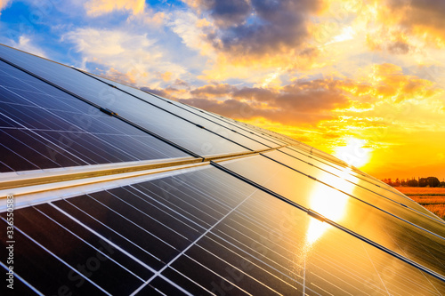 Fotografie, Tablou Photovoltaic solar panels on sunset sky background,green clean energy concept