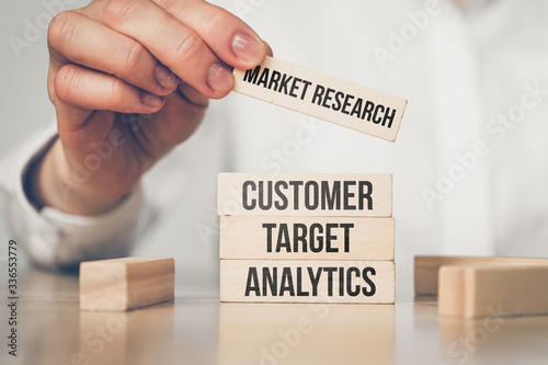 Fototapety, obrazy: Market research concept - hand holds wooden block and the inscription analytics, target, analytics.