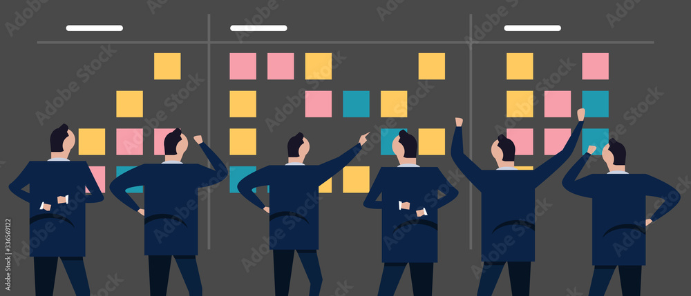 Fototapeta Employee businessman looking together at sticky notes planning concept of scrum agile in business