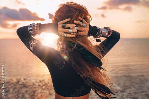 beautiful young tribal style woman on the beach at sunset Fototapeta