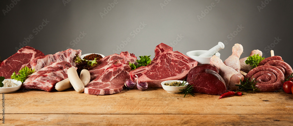 Fototapeta Selection of gourmet meats on rustic timber board