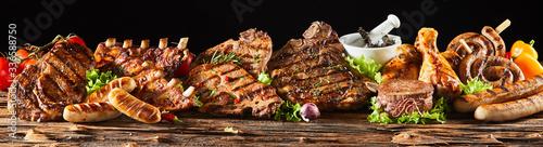 Fototapeta Various barbecued gourmet meats on timber board obraz na płótnie