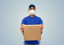 Health, Safety And Pandemic Concept - Happy Indian Delivery Man Wearing Face Protective Mask Or Respirator For Protection From Virus Disease With Parcel Box In Blue Uniform Over Grey Background