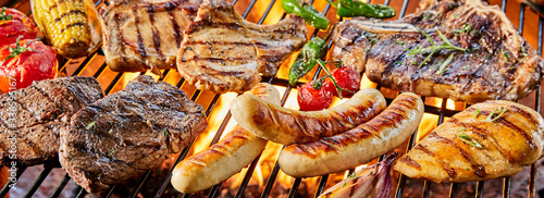 Large assortment of meat grilling on a barbecue Wallpaper Mural