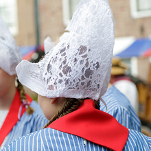 Woman Wearing A Traditional Costume During The Weekly Cheese Market, Edam, The Netherlands.