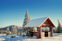 Wooden Pavilion On Snowy Mount...