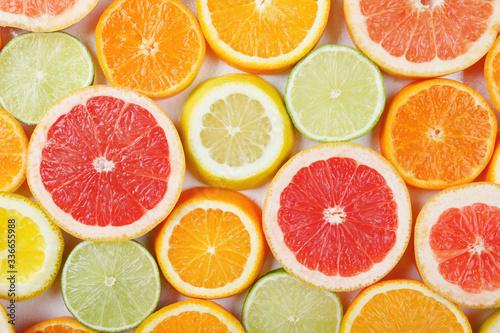 Citrus fruit pattern made of lemon, orange, grapefruit and lime.