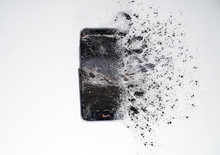 Mobile Smartphone With Broken Screen And .splinters On White Background.