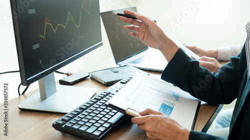 Fototapeta Business team investment Entrepreneur Trading discussing and analysis graph stock market in traders office. Business financial exchange concept obraz
