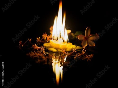 Obraz na plátně burning candle on black background