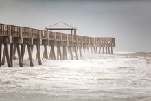 Angry Ocean With Wave Crashing Against Pier
