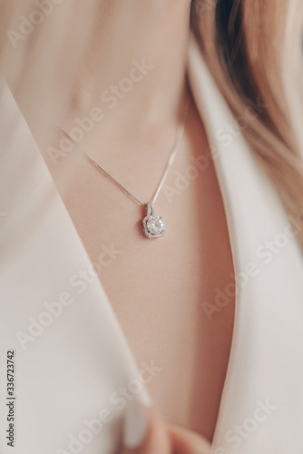 Fotografie, Obraz Woman wearing elegant pendant necklace with diamond on close-up