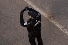 A Policeman Taking A Mobile Ph...