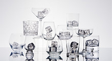 Variety Of Glasses With Ice Cubes On Table