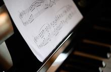 Closeup Of A Piano Keyboard And A Music Sheet
