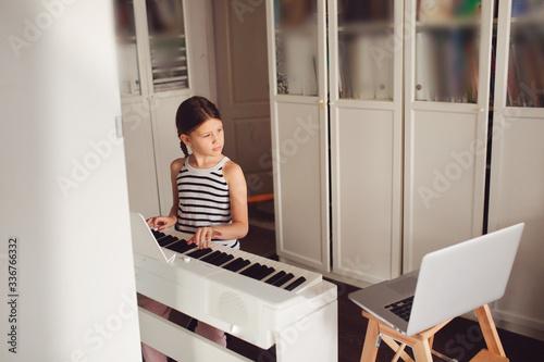 Carta da parati Remote music lesson, child playing digital piano
