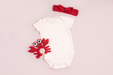 Cute Baby Bodysuit With Toys. ...
