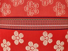 Full Frame Shot Of Floral Pattern On Red Bamboo Mat