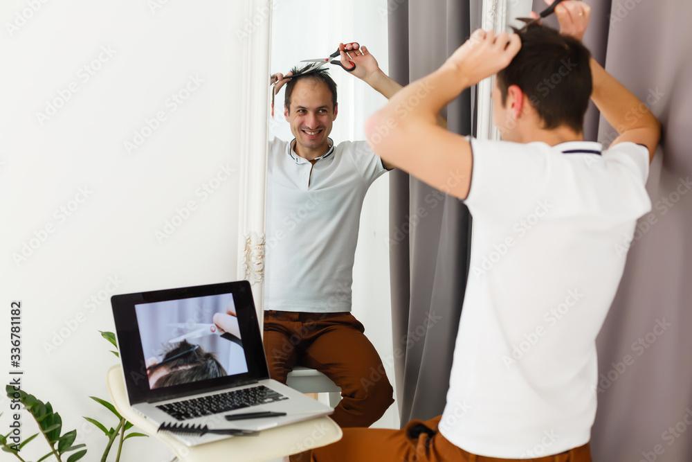 Fototapeta coronavirus mens haircut at home, online hairdressing tutoring on a laptop