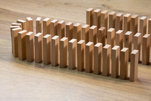 Closeup Of Lined Wooden Dominoes, On Wooden Top