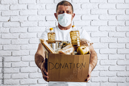 Fototapeta Donation box of food for people suffering from coronavirus pandemia consequences