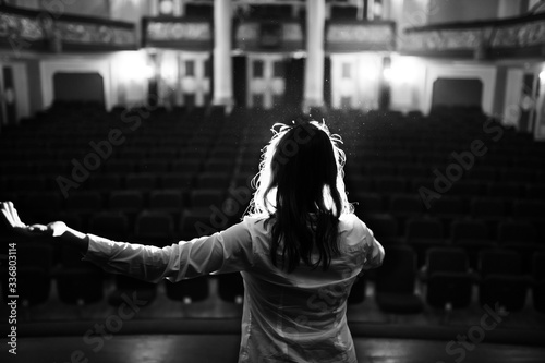 Tablou Canvas Entertainer performing on a stage in a empty theater,concert hall without fans
