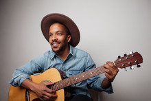 Portrait Of Happy Bearded Black Man Playing Guitar Isolated On White Background.