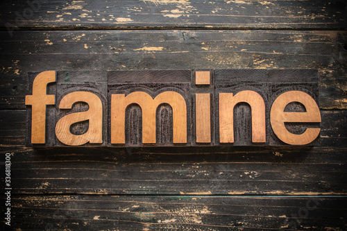 Vászonkép Famine Concept Vintage Wooden Letterpress Type Word
