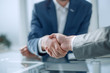 close up. business handshake over the office Desk