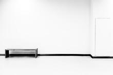 Bench On Floor Against White W...