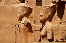 Statues Carved On Ancient Egyptian Temple Wall
