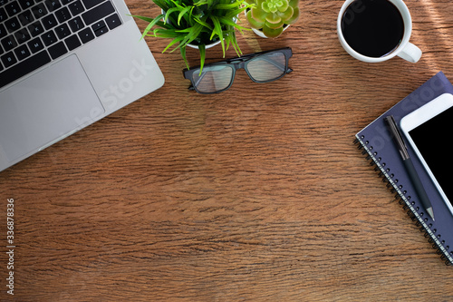Workplace at home with wood table Wallpaper Mural