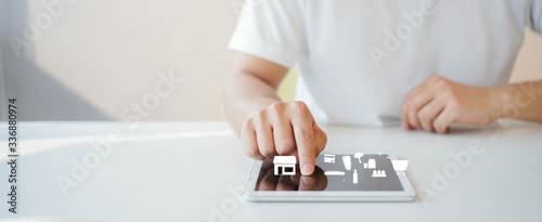 Leinwand Poster close up young man hand on digital tablet screen to choose and order fresh produ
