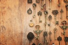 Image Of Old Antique Keys And Clocks Over Wooden Background. Top View, Flat Lay