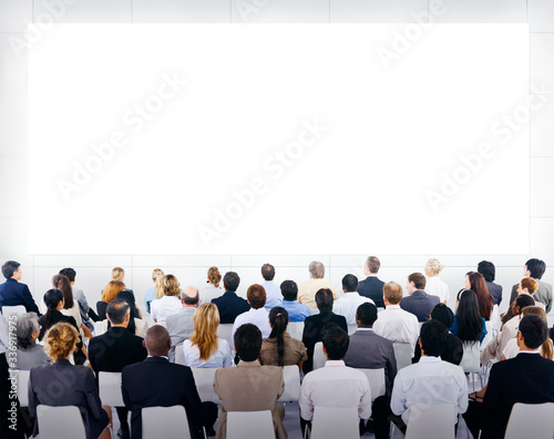 Group of business people sitting and looking at the blank presenation Wallpaper Mural