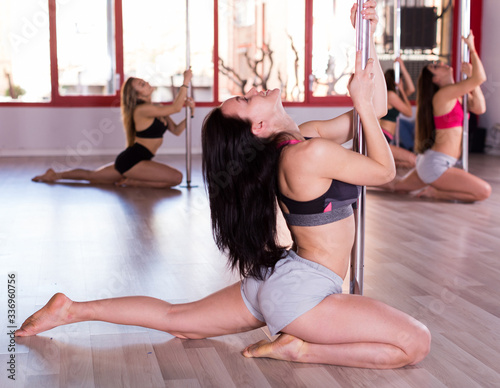 Fototapeta Women practicing pole dancing obraz