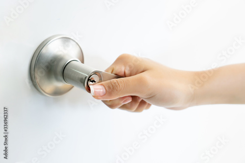 Fototapety, obrazy: focus and close up at hand of young woman hold and open door knob during home working, infectious corona virus or covid-19 spread concept