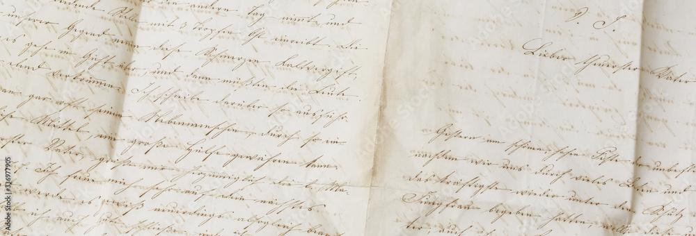 Fototapeta closeup of old handwriting; vintage paper background