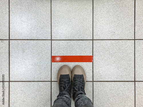 Woman keeps social distance in a post office, queues at the red line during the Fototapete
